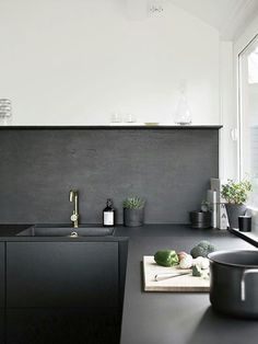 If contemporary design is what you're after, consider adding purely utilitarian surfaces, like concretekitchen countertops, throughout your space. The material is eco-friendly and affordable, and when painted or sealed in a sleek color, like the matte charcoal counters featured in this kitchen, the look feels fresh yet approachable.