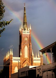 Rainbow behind St. Mary's Basilica, Natchez, Mississippi. Photo by Ben Hillyer
