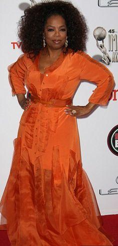 Oprah Winfrey.  Yessss ms. Oprah! Rocking my favorite color....