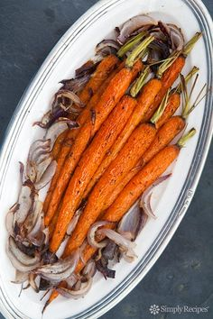 Roasted Baby Carrots ~ Tender young carrots, roasted with red onions with rosemary, salt, and pepper, until lightly caramelized. ~ SimplyRecipes.com