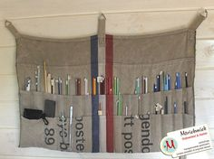 Hanging storage for knitting needles made from a Dutch postal bag(?) by Marieke van Esveld, via Flickr