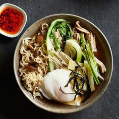 Homemade Pork Ramen: succulent pork shoulder, poached egg, bok choy, enoki mushrooms, crisp nori (seaweed) and a splash of chili oil. Recipe: http://www.midwestliving.com/recipe/pork-ramen/