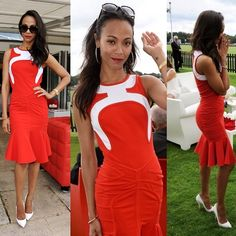#style: Zoe Saldana beamed in an Antonio Berardi Resort 2014 sizzling red dress! It features a graphic white detail that encases the neckline, more graphic lines in the same hue as the dress that contour the waist and hips and a flouncy knee-length bottom. She completed her look with python Christian Louboutin 'Batignolles' pumps.