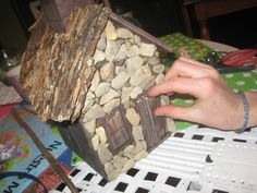 A wooden craft store bird house can become a fairy home with a glue gun, stones and sticks DIY @dapperhouse