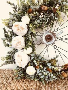 Vintage Succulent Bike Wheel Wreath with peonies, pine cones and eucalyptus.