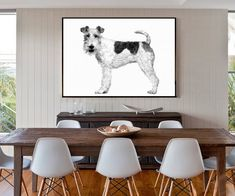 A gorgeous piece of ready to hang art featuring a characterful picture of a black and white dog.Bring a touch of humour and contemporary style into your home with this adorable black and white photograph of a happy pooch. The piece is perfect for adding a talking point to a living room, childs bedroom or office. The black frame is part of the design and comes printed onto the canvas creating a stunning piece of art that's ready to hang. The canvas is printed to the highest quality from the…