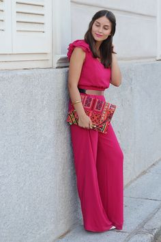 pink jumpsuit with embroidered clutch