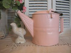 I have a pink watering bucket... I also have broken china pieces with pink roses to embellish it, but I just haven't gotten around to it, yet.
