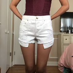 "Off white high waisted destroyed vintage cutoffs F21 Off white high waisted destroyed ""vintage"" shorts. Adorable gold embellishments. Studs and buttons. Cut off cuffs. Not Brandy Melville but tagged for exposure Brandy Melville Shorts Jean Shorts"