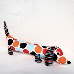 perfect crib accessory. an orange and blue dachshund plush