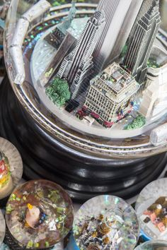 Manhattan - large globe featuring the Twin Towers and a subway train around the inside of the globe.