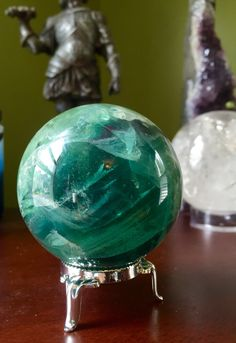A personal favorite from my Etsy shop https://www.etsy.com/listing/279769578/gorgeous-green-fluorite-sphere-orb