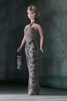 Armani Barbie® doll wears an elegant re-creation of an original Giorgio Armani gown. Intricate beadwork lends sophisticated glamour to the long skirt. Barbie Mode, Barbie I, Barbie World, Barbie Blog, Barbie Gowns, Barbie Dress, Barbie Clothes, Giorgio Armani, Manequin