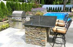 Stacked Stone outdoor kitchen with Granite countertop.