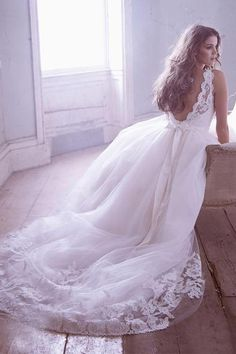 The back of a dress is just as important as the front. The lace detailing at the back and the train help to complete the look.