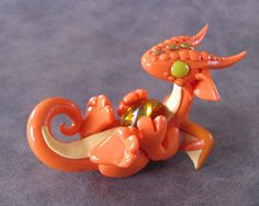 Adorable clay dragon made by Becca Golins.