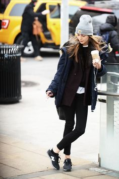 Shop this look on Lookastic: http://lookastic.com/women/looks/beanie-crew-neck-t-shirt-cropped-sweater-scarf-double-breasted-blazer-parka-skinny-jeans-low-top-sneakers/7896 — Grey Beanie — White Crew-neck T-shirt — Black Cropped Sweater — Dark Brown Fur Scarf — Dark Brown Wool Double Breasted Blazer — Navy Parka — Black Skinny Jeans — Black Low Top Sneakers