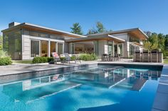 Flavin Architects together with interior design firm Jane Young Design, have completed this contemporary home in Lenox, Massachusetts, that's surrounded by trees.