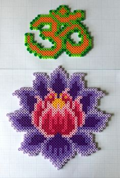 Ohm and lotus perler bead wall art