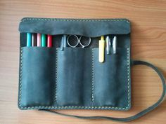 Handmade Gray cowhide leather pencil case.    This is a great case for writing tools.    Protection with class, quality, beauty and durability.