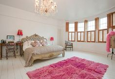 Romantic bedding, chandelier combo.