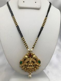 Beautiful and traditional look Lakshmi print pendant with black beads chain Antique Jewellery Designs, Gold Earrings Designs, Gold Jewellery Design, Bead Jewellery, Necklace Designs, Beaded Jewelry, Beaded Necklace, Silver Jewelry, Handmade Jewelry