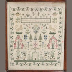 An early Victorian sampler, depicting a Georgian house in a garden with peacocks, lions rampant, flowering urns, and Adam & Eve under the apple tree with the serpent, signed and dated Elizabeth Sarah Longman 1841
