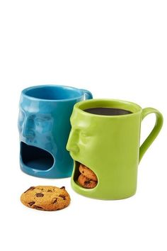 These face mugs have storage at the bottom that can hold your snacks while you drink your coffee.