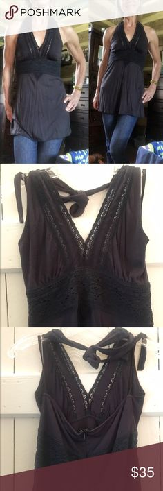 Adorable BCBGirls black tunic tank top!  Adorable BCBGirls black tunic tank top!  Sexy V neck with lace detail!  Excellent used condition!  Zip up back...size 4.  BCBGirls Tops Tunics