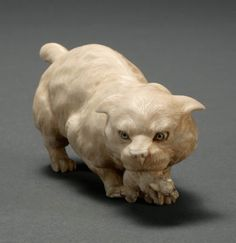 JAPANESE CARVED IVORY FIGURE OF A CAT, SIGNED: KAZUMASA, MEIJI PERIOD, LATE 19TH CENTURY
