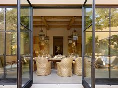 Metal French Doors, floor to ceiling, Mediterranean Dining Room by Ken Linsteadt Architects