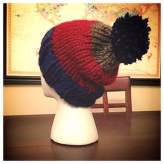 Blue, Red, and Brown Beanie with a Blue Poof on Etsy, $16.00