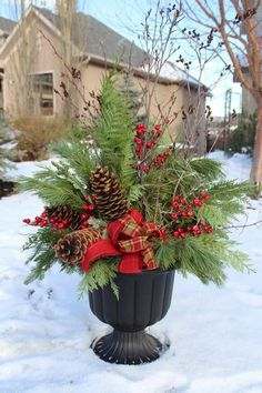 24 Stunning Christmas pots and planters to DIY for almost free! How to create co… 24 Stunning Christmas pots and planters to DIY for almost. Christmas Urns, Outdoor Christmas Decorations, Christmas Centerpieces, Country Christmas, Christmas Time, Thanksgiving Holiday, Green Christmas, Garden Decorations, Christmas Garden