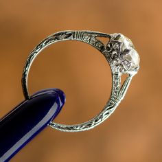 A delicate and beautiful old European cut diamond engagement ring. A profile view of all the stunning craftsmanship.
