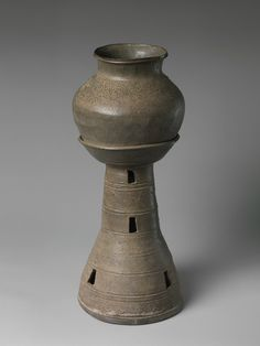 Jar and tall stand with perforated base, Three Kingdoms period, Silla Kingdom (57 B.C.–A.D. 668), mid-5th century. Korea. Stoneware with traces of incidental ash glaze; H. 21 1/2 in. (54.6 cm). The Metropolitan Museum of Art, New York, Purchase, Lila Acheson Wallace Gift, 1997 (1997.34.24a, b) © 2000–2015 The Metropolitan Museum of Art.