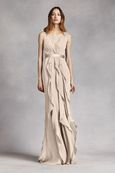 This V-neck wrapped bodice dress istimeless and romantic; perfectfor your wedding party or any special occasion!  SleevelessV-neck wrapped bodice is adorned with an elegant satin belt.  Long, soft chiffon skirt features cascading bias cut ruffles.  Sizes 0-26.  Fully lined. Back zipper. Imported chiffon. Dry clean only.