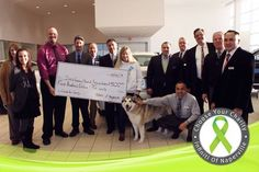 """Thank you Kim and rescuee Dalton (the photogenic Malamute) for taking time to visit with us today. Kim and Dalton claimed a $500 donation for Illinois Alaskan Malamute Rescue Association's (IAMRA) January win in our """"Choose Your Charity"""" contest, held monthly. — at Infiniti of Naperville-Lisle."""