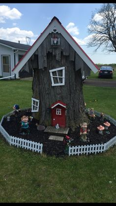 Most amazing Gnome Home. A lot of detail and Gnome Decor. Used an old tree stump and some well placed accents.