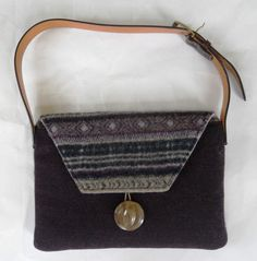 Only a handful of our Original Shoulder Bags left!  On sale! Forty percent off original price of $245.00  This gorgeous, limited edition, Upcycled, shoulder bag is perfect for you Perfect for the 11 or 13 MacBook Air or equal size ultra-thin Notebook.  Outside dimensions:15 by 10 . Inside dimensions: 14 by 9.  The back and front flap were reincarnated from a eggplant-purple, gray, navy and yellow felted fair isle wool sweater. The front was reincarnated from eggplant herring bone wool coat…