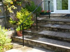 hand rail for outdoor steps Porch Handrails, Exterior Stair Railing, Outdoor Stair Railing, Iron Stair Railing, Front Path, Front Steps, Garden Steps, Garden Paths, Garden Railings