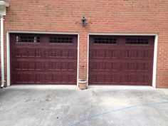 Two Single Dark Wood Grain Recessed Panel Carriage House Garage Doors
