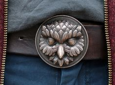 "I'm working on a series of belt buckles with animal characters.  This is the first one, called ""Owliver"". New gang members will join soon.  What Owliver likes most about being an owl:  The night life,  moving like a ghost  and this distinguished and mysterious aura every owl is born with.  You could say ""creepy"" and ""suspicious"" instead, but in this case, you are obviously not a friend of owls! Manufactured via Shapeways 3d printing service."
