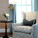 living rooms - cafe au lait walls antique brass swing-arm floor lamp white blue wingback chair vintage pedestal table  Chic, elegant living room