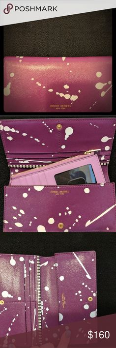 Henri Bendel Kangaroo wallet The splatter edition. An adorable accessory. Just a pop of color to any bag. Lightly used. henri bendel Accessories