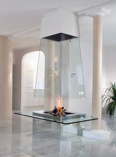This glass fireplace is perfectly at home in this contemporary, minimalist interior.  An unobtrusive, yet eye catching feature.