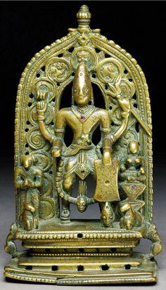 Shiva as Virabhadra, a warrior who destroyed Daksha Yagna after Sati immolated herself in the fire of a ritual horse sacrifice. Daksha is below left with ibex head. 16-17th C. Brass, Karnakata, India