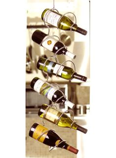 """Climbing Tendril Wine Rack for $39.00. Find this wine rack and more at WineRacks.com     Hanging wine rack holds 6 individual bottles. Includes hanging bracket. Available in Chrome, Black, or Copper finish.    Dimensions: 40""""H x 10""""W"""