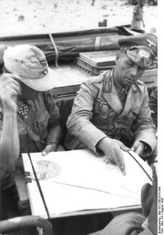 Rommel studying a map with his staff officers, North Africa, Aug 1942