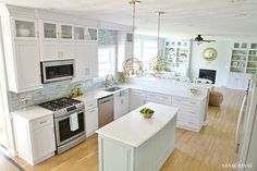 Sand and Sisal's Coastal Kitchen Makeover. May 2016.  The paint colors in the kitchen are the following: kitchen walls- Sherwin Williams Comfort Gray family room walls – Sherwin Williams Sea Salt white cabinets – Sherwin Williams (custom white color) but closest would be Extra White island color – Sherwin Williams Oyster Bay