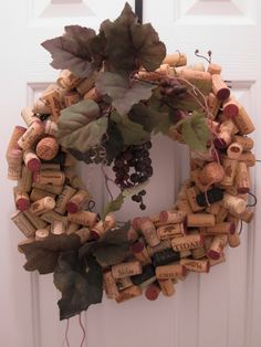 I made this wreath with wine corks, a grapevine wreath, a few grapes & leaves, and a lot of glue. I used a piece of rafia for the hanger. (July 23, 2013)